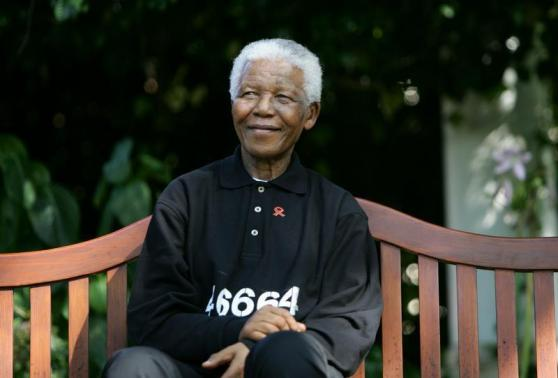 File photo of Nelson Mandela smiling at a news conference ahead of the second 46664 concert ...