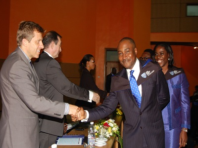 Mr. Andrew Enahoro, Head Legal and Public Relations, Promasidor Nigeria Limited, shaking hands with Professor Juan Elegido, Vice Chancellor, Pan Atlantic University and Mr. Joseph Hudson, MD/CEO, Lafarge Cement WAPCO Nig. Plc at a graduation ceremony from Advanced Management Course, Lagos Business School (LBS),  Pan Atlantic University (PAU) in Lagos recently.