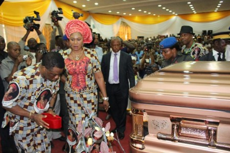 Chief Willie Obiano, Governor of Anambra State, paying his last respect to the body of Prof. Dora Akunyili at the Special Honours & Tributes Ceremony in Awka...Wednesday. With him is Ebelechukwu, his wife.