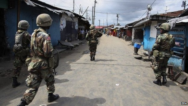 Liberian troops trying to contain riots in Monrovia slums after Government restricted movements following the out break of Ebola Virus Disease