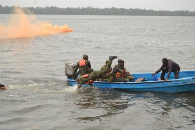 PIC 10. NEWLY RECRUITED SOLDIERS DISPLYING THEIR WATERMANSHIP SKILLS FOR SPECIAL INTERNAL SECURITY OPERATIONS ORGANISED BY 2 BRIGADE NIGERIAN ARMY, PORT HARCOURT IN HARRY'S TOWN, DEGEMA LGA OF RIVERS ON SUNDAY (28/02/2016).  1230/28/02/2016/DESMOND/ICE/NAN